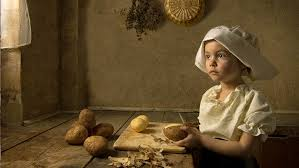 child cutting potatoes