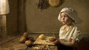 child cutting potatoes