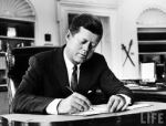 JFK at desk