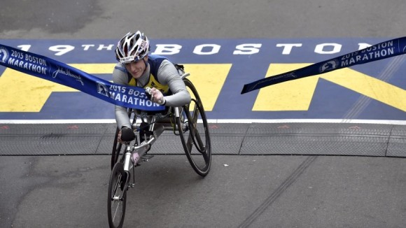 Tatyana McFadden, of the U.S. wins the women's wheelchair division at the 119th running of the Boston Marathon in Boston,