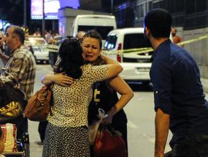 ISTANBUL, TURKEY - JUNE 28: Passengers who survived from the suicide bomb attack cry as they leave the Turkey's largest airport, Istanbul Ataturk, June 28, 2016, Turkey. Three suicide bombers opened fire before blowing themselves up at the entrance to the main international airport in Istanbul, killing at least 28 people and wounding at least 60 people according to Istanbul governor Vasip Sahin. (Photo by Gokhan Tan/Getty Images)